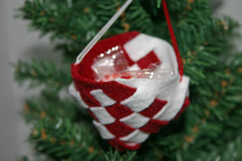 Felt Basket Ornament finished and filled with candy hanging on the Christmas tree