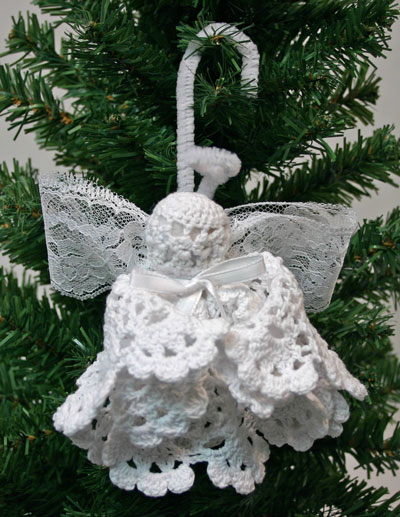 Doily Angel hanging on tree