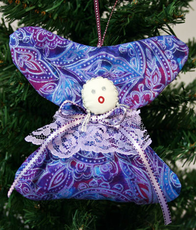 Quilters Angel hanging on tree