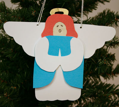 Paper Angel hanging on tree