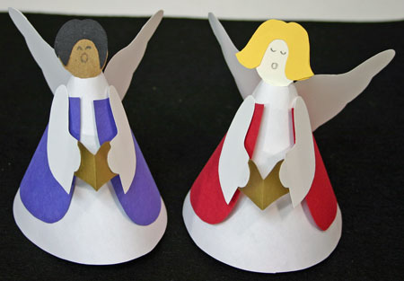 Two singing angels made of paper