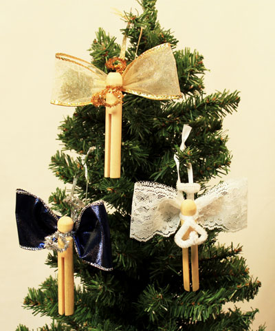 Clothespin angel ornaments - three finished hanging on a Christmas Tree