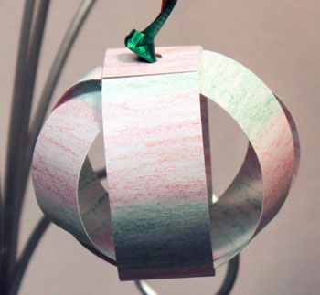 Christmas ornaments paper sphere crayon on white finished
