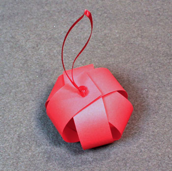 Christmas ornaments paper sphere step 11 double knot ribbon on top