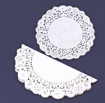 Easy Angel Crafts Doily Paper Angel step 1 fold larger paper doily in half