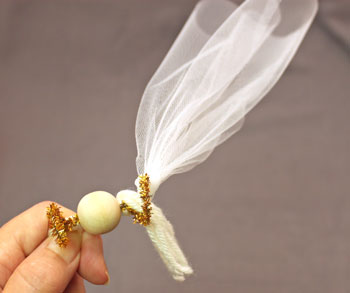 Easy Angel Crafts Tulle Angel step 12 pull the tulle ends firmly