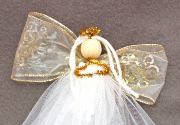 Easy Angel Crafts Tulle Angel step 16 add the ribbon to the angel