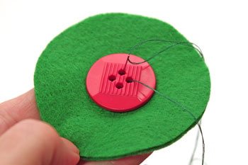 Easy Christmas Crafts Button Wreath Ornament step 2 sew button to center of two circles