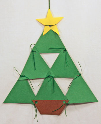 Easy Christmas Crafts Construction Paper Triangles Christmas Tree hanging on a wall