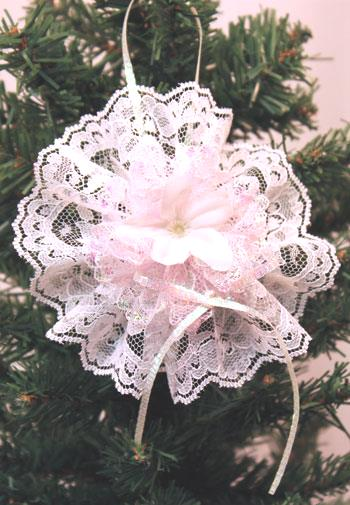 Completed white and pink easy Christmas crafts lace flower ornament hanging on the tree
