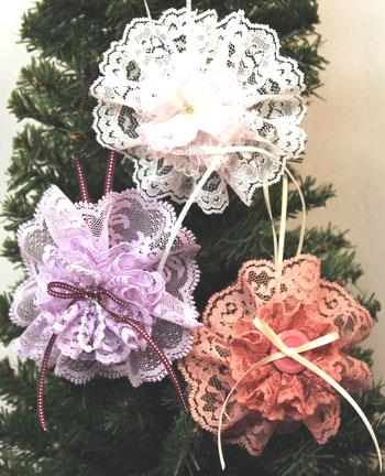 Three completed Easy Christmas Crafts Lace Flower Ornaments hanging on a tree