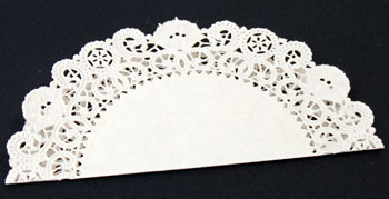 Easy Christmas Crafts Paper Doily Cone Ornament step 2 fold the paper doily in half