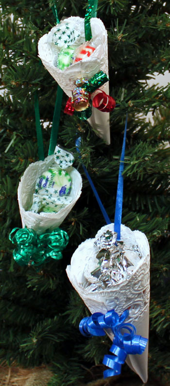 Easy Christmas Crafts Paper Doily Cone Ornament three finished hanging on tree