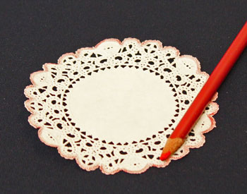 Easy Christmas Crafts Paper Doily Folded Christmas Tree Ornament step 1 color around the doily edge