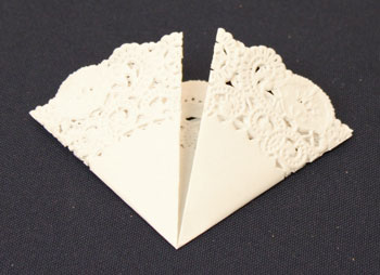 Easy Christmas Crafts Paper Doily Greeting Card Ornament step 2 fold doily into arc