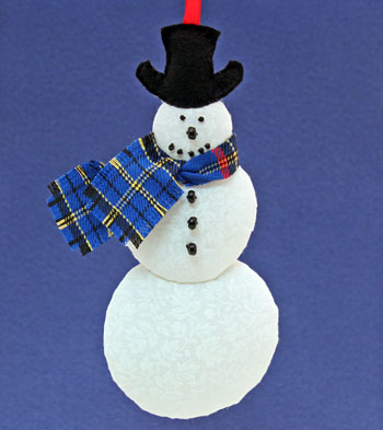 Easy Christmas Crafts Snowman finished ornament hanging from ribbon