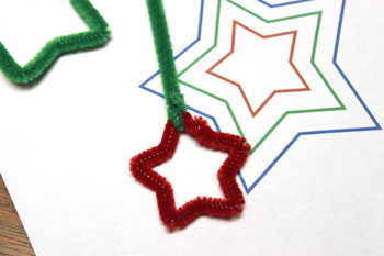 Easy Christmas Crafts Three Stars Chenille Ornament step 10 attach short green wire to top of red star