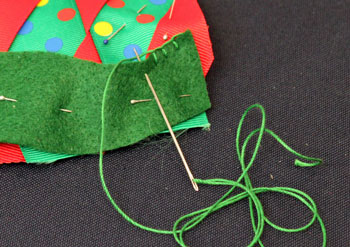 Easy Christmas Crafts Woven Ribbon Christmas Tree Door Hanger step 11 stitch along top edge of felt strip
