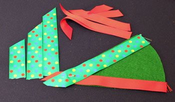 Easy Christmas Crafts Woven Ribbon Christmas Tree Door Hanger step 6 begin weaving ribbon