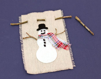 Easy Christmas Crafts Felt and Twig Snowman step 11 insert twig hanger