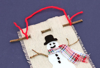 Easy Christmas Crafts Felt and Twig Snowman step 12 add yarn