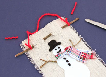 Easy Christmas Crafts Felt and Twig Snowman step 13 trim yarn