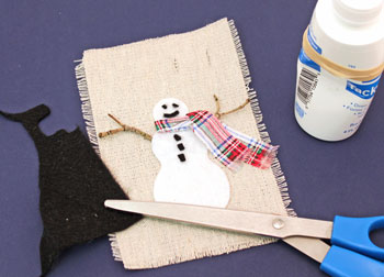 Easy Christmas Crafts Felt and Twig Snowman step 9 glue buttons and face