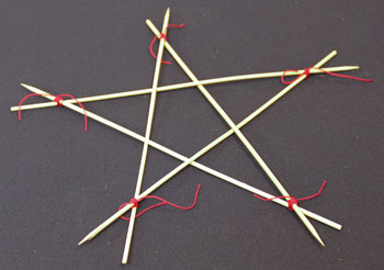 Easy Christmas Crafts Five Point Wooden Star step 8 wrap and secure yarn around each point