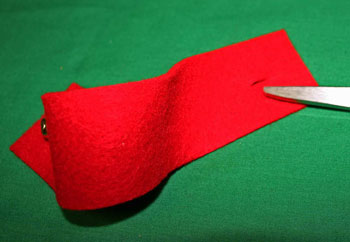 Easy felt crafts napkin ring red with bell cut buttonhole