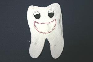 Easy felt crafts tooth pillow pin front and back together