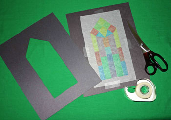 Easy paper crafts faux stained glass window taped to frame