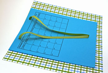 Easy paper crafts pocket calendar step 5 insert ribbon through holes