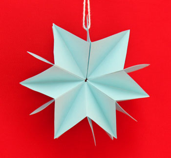 Folded Paper Squares Star blue 6 point on display