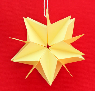 Folded Paper Squares Star yellow 5 point on display