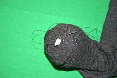 Frugal-Fun-Crafts-Mending-Socks-with-light-bulbs-trouser-sock-hole-with-bulb-small-stitches