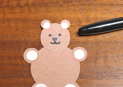 Paper Circles Teddy Bear step 12 draw eyes and mouth