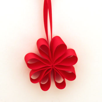 Ribbon Flower Ornament on display using red grosgrain ribbon