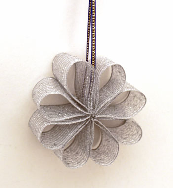 Ribbon flower ornament in silver hanging for display