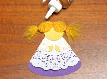 Cardstock and Doily Angel step 16 glue hair