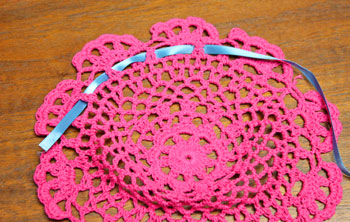 Crocheted Doily Wrapped Ornament step 2 begin weaving ribbon