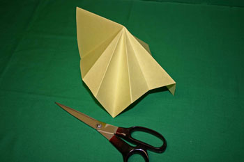 Easy Christmas crafts - folded paper Christmas tree fold halfway between earlier folds