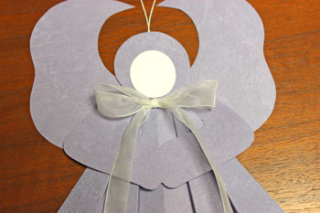 Folded Square Paper Angel step 15 position bow
