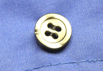 the results of the how to sew on a button steps