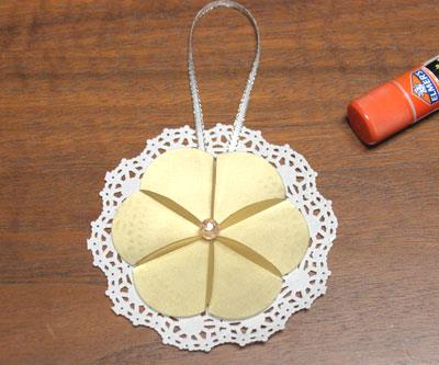 Paper Circles Triangle Doily Ornament step 9 glue bead to center of circles