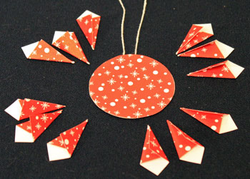 Easy Christmas Crafts Paper Pinwheel Wreath Ornament step 10 three in each quadrant