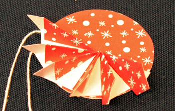 Easy Christmas Crafts Paper Pinwheel Wreath Ornament step 14 second quadrant finished