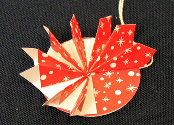 Easy Christmas Crafts Paper Pinwheel Wreath Ornament step 15 third quadrant finished