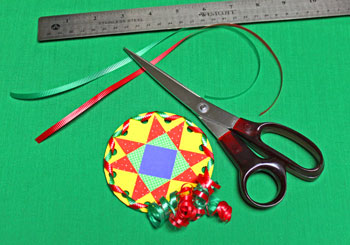 Paper Quilt Patch Ornament step 16 measure and cut ribbons for hanging loop